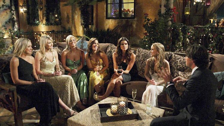 "In this 2011 photo released by ABC, bachelor Ben Flajnik, right, gets to know bachelorettes during the taping of the latest season of the romance competition series ""The Bachelor,"" in Westlake, Calif. (AP Photo/ABC, Rick Rowell)"