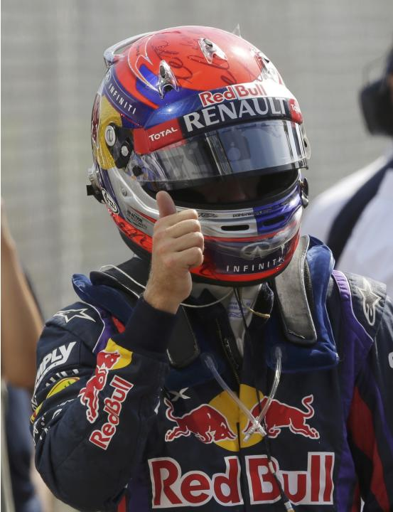 Red Bull Formula One driver Vettel celebrates taking the pole position in the qualifying session of the Italian F1 Grand Prix at the Monza circuit