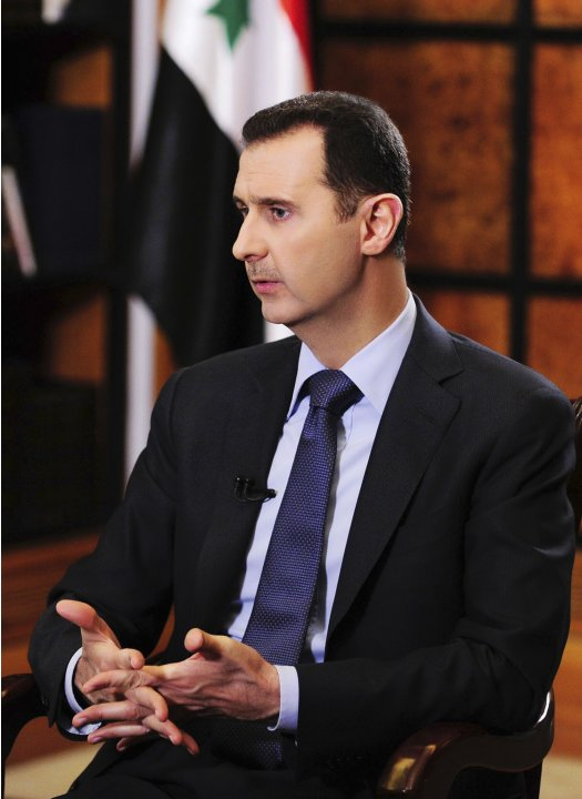 Syria's President Bashar al-Assad gestures during an interview with journalists from Argentina in Damascus