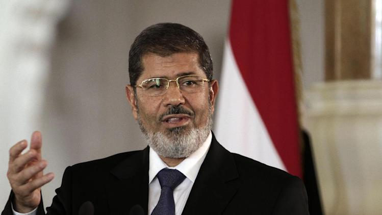 FILE - In this July 13, 2012 file photo, then Egyptian President Mohammed Morsi speaks to reporters at the presidential palace in Cairo. An Egyptian judge says Jan. 28 has been set as opening day for the third trial of Morsi, this one on charges of organizing prison breaks with the help of foreign militants. (AP Photo/Maya Alleruzzo, File)