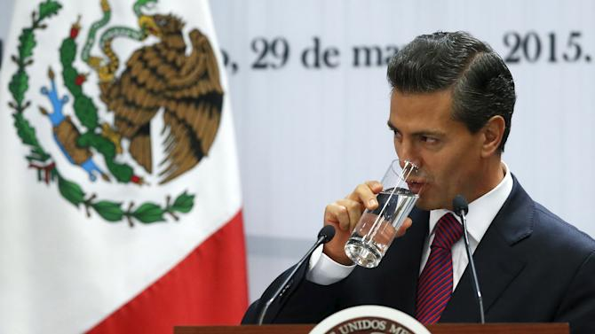 Mexico's President Nieto drinks as he speaks during investment announcement from  brewer Grupo Modelo in Merida in Yucatan state, at Los Pinos Presidential house in Mexico City