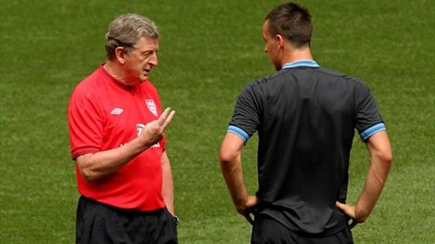 England's manager Roy Hodgson talks to John Terry (PA)