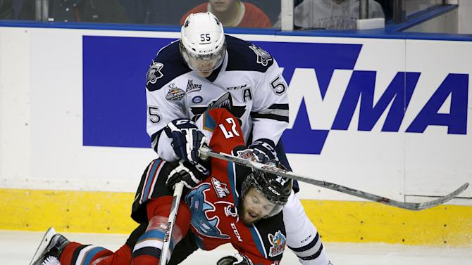 Rimouski Oceanics Samuel Morin hits Kelowna Rockets Josh Morrissey during the second period of their Memorial Cup hockey game at the Colisee Pepsi in Quebec City