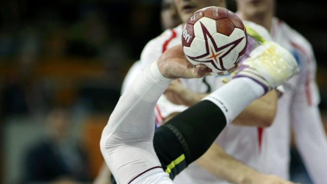 Vidal of Qatar attempts to score during the round of 16 match against Austria in the 24th men's handball World Championship in Doha