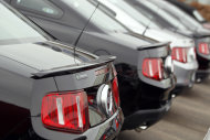 This Feb. 19, 2012 photo, shows a long line of 2012 Mustangs at a Ford dealership in the south Denver suburb of Littleton, Colo. U.S. factories stepped up production in February for the third straight month, helping the economy recover and driving the best job growth since the recession ended. (AP Photo/David Zalubowski)