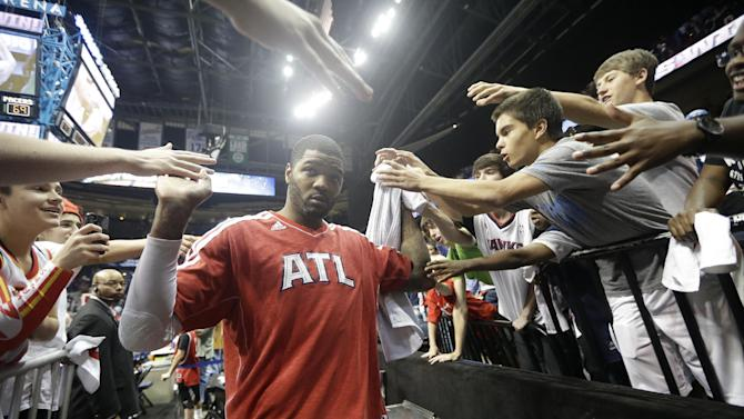 Atlanta Hawks small forward Josh Smith (5) walks off the court after the second half in Game 3 of their first-round NBA basketball playoff series, against the Indiana Pacers, Saturday, April 27, 2013 in Atlanta. Atlanta won 90-69. (AP Photo/John Bazemore)