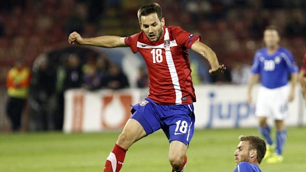 Milos Ninkovic in action for Serbia (Reuters)