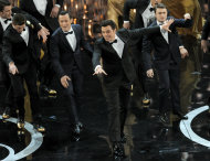 From second left, actors Joseph Gordon-Levitt, Seth MacFarlane and Daniel Radcliffe perform onstage during the Oscars at the Dolby Theatre on Sunday Feb. 24, 2013, in Los Angeles. (Photo by Chris Pizzello/Invision/AP)