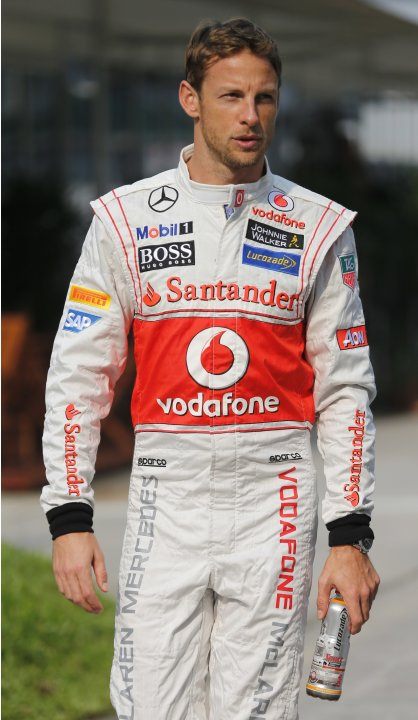 McLaren Formula One driver Jenson Button of Britain walks in the paddock of Sepang International Circuit