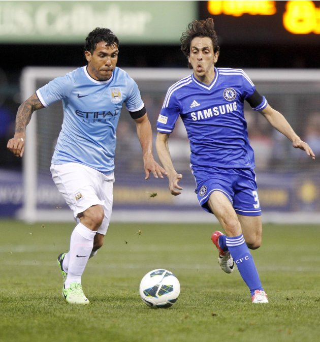 Manchester City's Carlos Tevez and Chelsea's Yossi Benayoun fight for the ball during their friendly soccer match in St. Louis