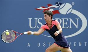 Suarez Navarro of Spain hits a return to Kerber of Germany at the U.S. Open tennis championships in New York