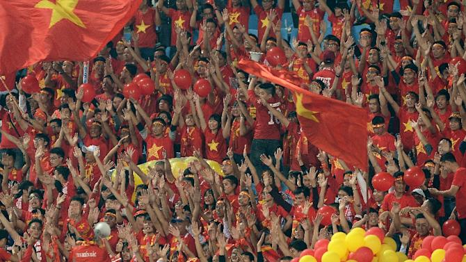 Vietnamese fans cheer on their team before the start of the Suzuki Cup semi-final 2nd leg match against Indonesia, at Hanoi's My Dinh stadium, on December 7, 2016