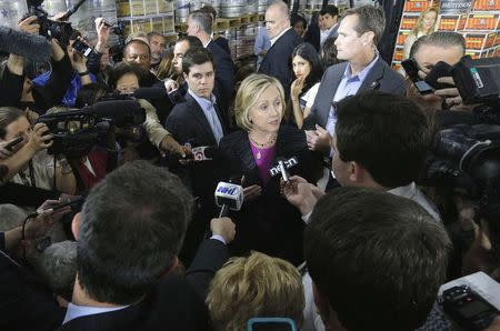 Democratic presidential candidate Clinton talks to the media after a campaign appearance at Smuttynose Brewery in Hampton
