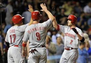 Paul, Votto hit HRs to help Reds rout Cubs, 12-2