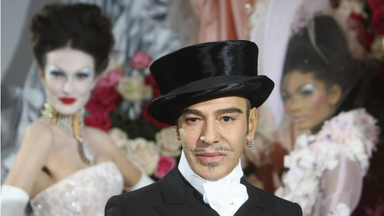 """FILE - In this Jan. 25, 2010 file photo, fashion designer John Galliano poses at the end of the presentation of the Dior Haute Couture spring/summer 2010 fashion collection in Paris. Galliano is planning to teach a master class some time this spring at Parsons The New School of Design in New York. The college said in a statement Monday, April 22, 2013, that the workshop will allow students to have a """"frank conversation"""" with Galliano. Galliano was the creative director at Christian Dior when he was fired in 2011 for making anti-Semitic comments, a crime in France. He is currently involved in a lawsuit against his former employer.   (AP Photo/Jacques Brinon, file)"""