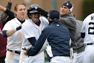 Don Kelly (2nd L) of the Detroit Tigers celebrates with teammates and manager Jim Leyland after Kelly hit the game-winning RBI sacrifice fly in the bottom of the ninth inning against the Oakland Athletics during Game Two of the American League Division Series at Comerica Park, in Detroit, Michigan. The Tigers won 5-4, to take a 2-0 lead in the best-of-five series