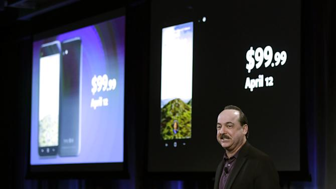 Ralph De La Vega, CEO of AT&T mobility, displays a new phone with the new Facebook interface at the Facebook headquarters in Menlo Park, Calif., Thursday, April 4,  2013. The company says its not building a phone or an operating system. Rather, Facebook is introducing  a new experience for Android phones. The idea behind the new Home service is to bring content right to you, rather than require people to check apps on the device.   (AP Photo/Marcio Jose Sanchez)