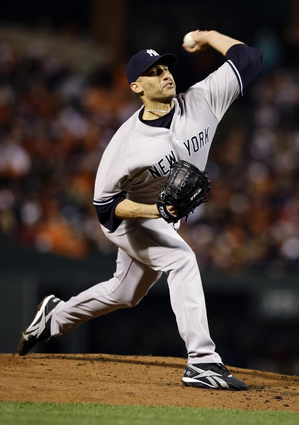 New York Yankees starting pitcher Andy Pettitte throws to the Baltimore Orioles in the first inning of Game 2 of the American League division baseball series on Monday, Oct. 8, 2012, in Baltimore. (AP Photo/Alex Brandon)