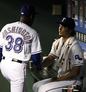 Texas Rangers manager Ron Washington (38) shakes hands with Yu Darvish, of Japan, after pulling him in the ninth inning of a baseball game against the New York Yankees on Tuesday, April 24, 2012, in Arlington, Texas. The Rangers won 2-0. (AP Photo/Tony Gutierrez)