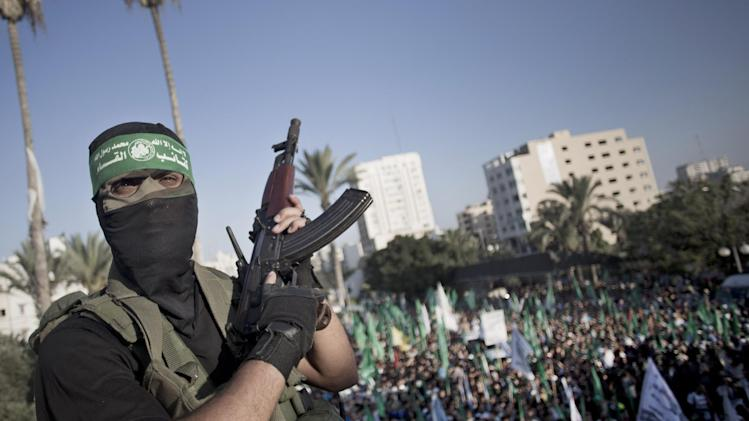 A Palestinian masked Hamas gunmen holds his rifle as he guards during a rally in Gaza City, Wednesday, Aug. 27, 2014. An open-ended cease-fire between Israel and Palestinian militants in the Gaza Strip was holding Wednesday. (AP Photo/Khalil Hamra)