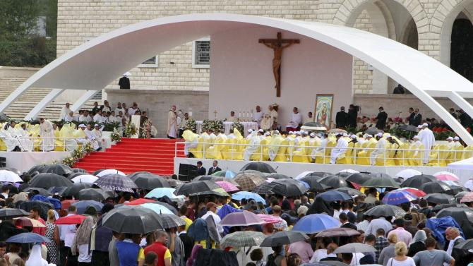 People attend a mass led by Pope Francis during his visit to Albania, in Tirana