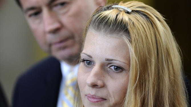 FILE - In this June 23, 2009, file photo Karolina Obrycka, right, with her attorney Terry Ekl, speaks outside the Cook County courthouse in Chicago, after Chicago police officer Anthony Abbate was sentenced to two years probation and anger management classes for the videotaped attack that appeared worldwide on the Internet and cable news channels. Allegations of a culture in which Chicago police jump to protect fellow officers accused of wrongdoing are at the heart of a federal civil trial that began Monday, Oct. 22, 2012, in Chicago that pits Obrycka, the victim of a barroom beating by an off-duty officer, against the city.  (AP Photo/Paul Beaty, File)