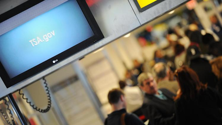 A video screen in a security line shows the website address of the US Transportation Security Administration (TSA)
