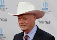 "Cast member of the TV series ""Dallas"" Larry Hagman arrives at the world premiere of the 40th anniversary restoration of the film ""Cabaret"" during the opening night gala of the 2012 TCM Classic Film Festival in Hollywood, California in this file April 12, 2012 photo. REUTERS/Fred Prouser"