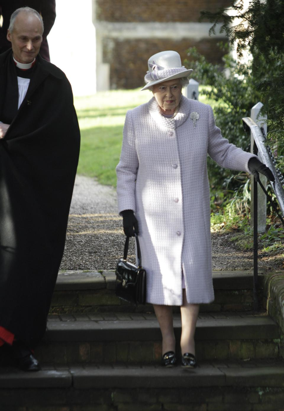 Britain's Queen Elizabeth II, right, leaves after she and other members of the royal family attended a Christmas Service at St. Mary's church on the grounds of Sandringham Estate, the Queen's Norfolk retreat, England, Sunday, Dec. 25, 2011. (AP Photo/Lefteris Pitarakis)