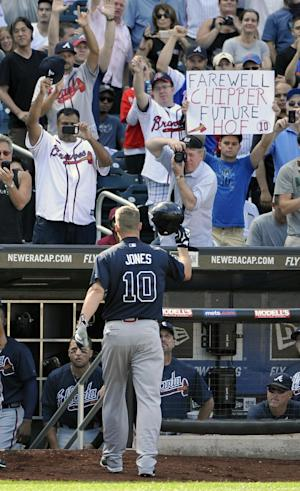 Fans hold posters and cheer for Atlanta Braves' Chipper Jones (10) as he walks off the field after being replaced for a pinch runner in the ninth inning of a baseball game against the New York Mets, Sunday, Sept. 9, 2012, at Citi Field in New York. Jones is retiring after the season and it was his last game at Citi Field. (AP Photo/Kathy Kmonicek)