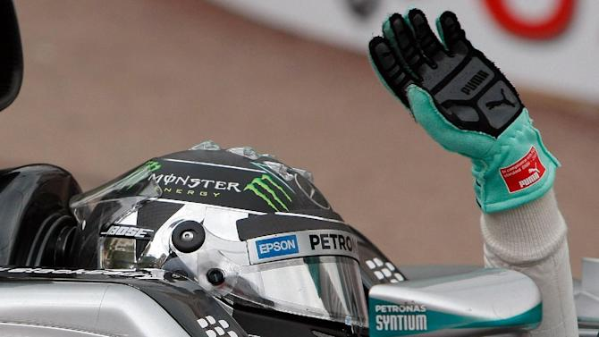 Mercedes driver Nico Rosberg of Germany waves to supporters after winning the Formula One Grand Prix, at the Monaco racetrack, in Monaco, Sunday, May 24, 2015. (AP Photo/Claude Paris)