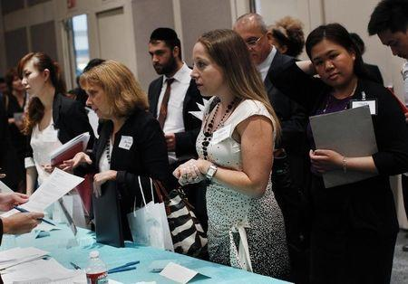 People speak with recruiters from jewelry and gem companies during the GIA Jewelry Career Fair in New York