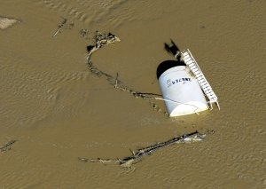 In this Sept. 17, 2013 photo, a crude oil storage tank…