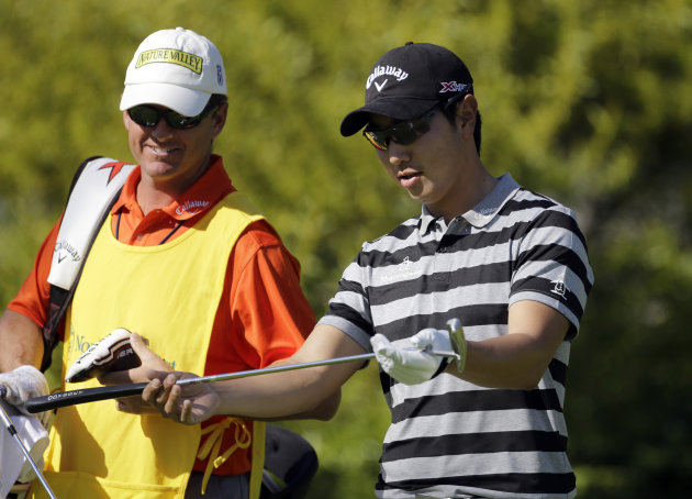 ADDS NAME OF CADDIE - Sang-Moon Bae, of South Korea, looks at his club on the sixth hole in the second round of the Northern Trust Open golf tournament at Riviera Country Club in the Pacific Palisades
