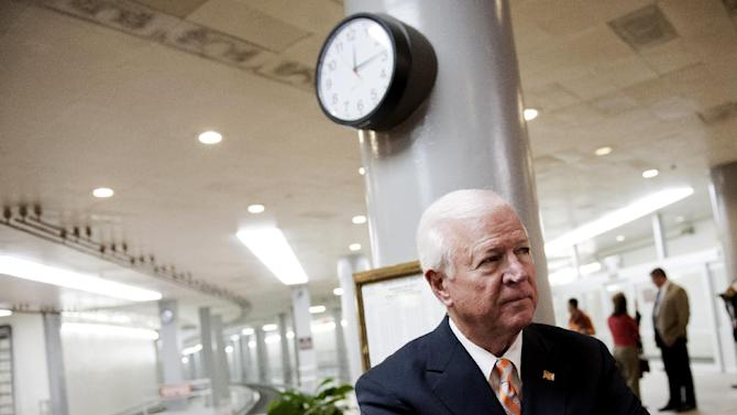 """FILE - In this Nov. 16, 2012 file photo, Senate Intelligence Committee Vice Chairman Sen. Saxby Chambliss, R-Ga., waits to speak with reporters on Capitol Hill in Washington. Chambliss announced Friday, Jan. 25, 2013, he will not seek a third term next year, saying """"this is about frustration"""" with Washington gridlock that he doesn't see changing in a divided government. (AP Photo/Cliff Owen, File)"""