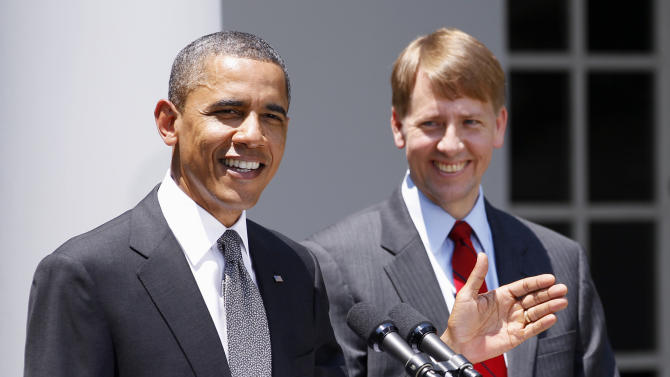 FILE - In this July 18, 2011 file photo, President Barack Obama and presidential nominee to serve as the first director of the Consumer Financial Protection Bureau (CFPB), former Ohio Attorney General Richard Cordray are seen in the Rose Garden of the White House in Washington. America's decision to re-elect President Barack Obama over Republican presidential candidate, former Massachusetts Gov. Mitt Romney will impact key sectors of the American economy.The 2010 overhaul of financial rules marked a victory for Obama. Officials who are still carrying out the details of the law may now be more likely to take a tough stance. (AP Photo/Manuel Balce Ceneta, File)