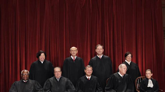 FILE - This Oct. 8, 2010 file photo shows the justices of the U.S. Supreme Court in a group portrait at the Supreme Court Building in Washington. The Supreme Court is embarking on a new term beginning Monday that could be as consequential as the last one with the prospect for major rulings about affirmative action, gay marriage and voting rights. Seated from left to right are: Associate Justice Clarence Thomas, Associate Justice Antonin Scalia, Chief Justice John G. Roberts, Associate Justice Anthony M. Kennedy, Associate Justice Ruth Bader Ginsburg. Standing, from left are: Associate Justice Sonia Sotomayor, Associate Justice Stephen Breyer, Associate Justice Samuel Alito Jr., and Associate Justice Elena Kagan. (AP Photo/Pablo Martinez Monsivais)