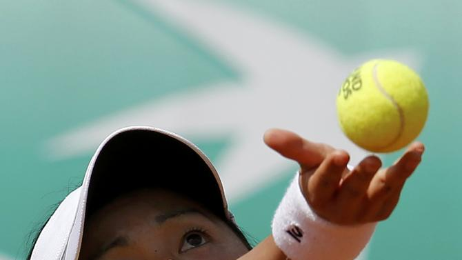 Misaki Doi of Japan plays a shot to Petra Cetkovska of the Czech Republic during their women's singles match at the French Open tennis tournament at the Roland Garros stadium in Paris