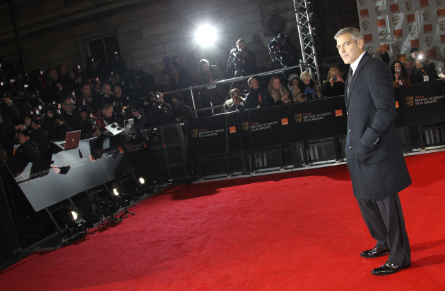 Actor George Clooney arrives for the BAFTA Film Awards 2012, at The Royal Opera House in London, Sunday, Feb. 12, 2012. (AP Photo/Joel Ryan)