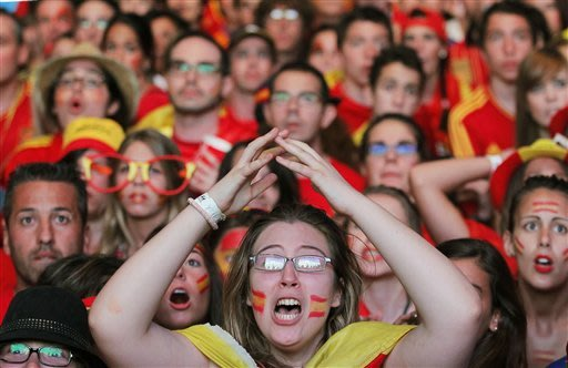 Spain fetes its soccer champs with happy abandon