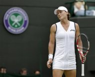 Samantha Stosur of Australia reacts during a second round women's singles match against Arantxa Rus of Netherlands at the All England Lawn Tennis Championships at Wimbledon, England, Wednesday, June 27, 2012. (AP Photo/Anja Niedringhaus)
