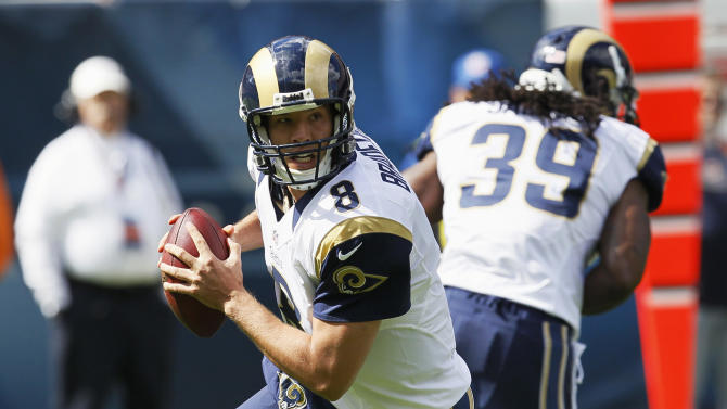 St. Louis Rams quarterback Sam Bradford (8) rolls out looking for a receiver against the Chicago Bears in the first half of an NFL football game in Chicago, Sunday, Sept. 23, 2012. (AP Photo/Charles Rex Arbogast)