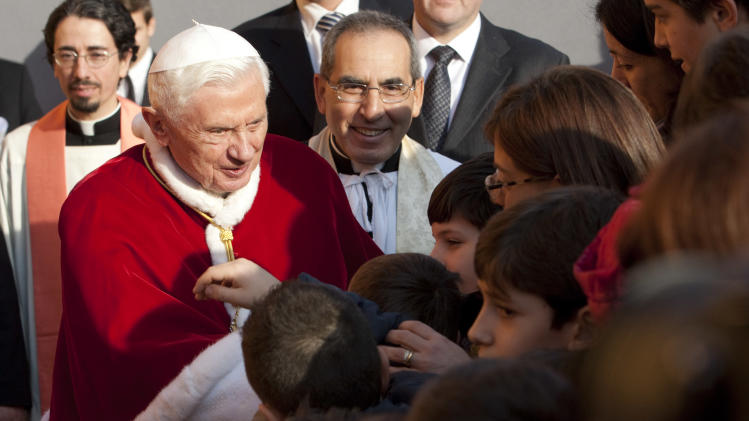 "Pope Benedict XVI arrives to celebrate mass in the ""Santa Maria delle Grazie"" parish church, in Rome, Sunday, Dec. 11, 2011. (AP Photo/Andrew Medichini)"