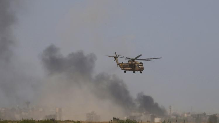 An Israeli Air force helicopter evacuates soldiers to a hospital in Israel after they were wounded during fighting in Gaza