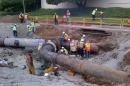 This image provided by the Los Angeles Department off Water and Power shows workmen putting together the replacement pipe before final testing on Saturday Aug. 2, 2014, in Los Angeles. Crews have finished repairs on an old water main that burst and poured 20 million gallons of water onto the UCLA campus. (AP Photo/LADWP)