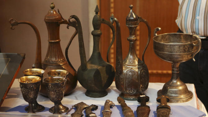 Recovered antiquities are displayed at the Iraqi National Museum in Baghdad, Iraq, Wednesday, July 29, 2015. Nearly 400 artifacts looted from Iraq amid the chaos of the 2003 U.S.-led invasion that toppled former Iraqi President Saddam Hussein were recovered by the Iraqi authorities recently from several sources. (AP Photo/Khalid Mohammed)
