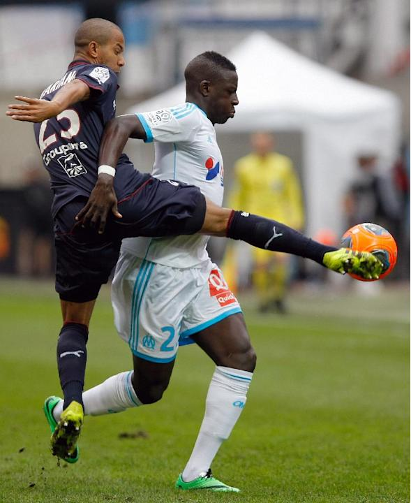 Marseille's French defender Benjamin Mendy, right,  challenges for the ball with Bordeaux's Brazilian defender Ferreira Filho Mariano, during their League One soccer match, at the Velodrome St