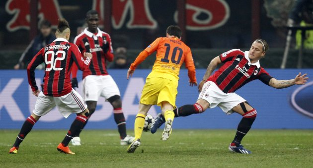 AC Milan's Mexes challenges Barcelona's Messi during their Champions League soccer match at the San Siro stadium in Milan