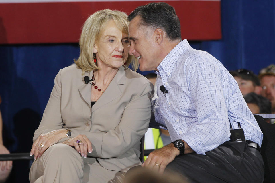 Republican presidential candidate and former Massachusetts Gov. Mitt Romney speaks with Arizona Gov. Jan Brewer as he campaigns with Republican governors at Basalt Public High School, in Basalt, Colo., Thursday, Aug. 2, 2012. (AP Photo/Charles Dharapak)