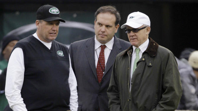 """FILE - In this Dec. 2, 2012, file photo, New York Jets head coach Rex Ryan, left, stands with general manager Mike Tannenbaum, center, and owner Woody Johnson before an NFL football game against the Arizona Cardinals in East Rutherford, N.J. Ryan insists he's a Jet all the way and wants to coach the team for the """"next 15 years."""" He dismisses as """"untrue"""" a report that says he would welcome being fired if Johnson doesn't upgrade the offense. (AP Photo/Kathy Willens, File)"""